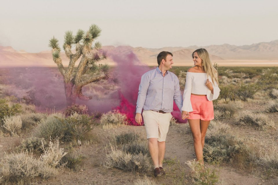 pink smoke bomb for baby announcement at Seven Magic Mountains