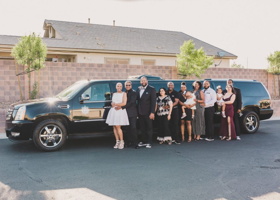 family poses by limo after vow renewal with Taylor Made Photography
