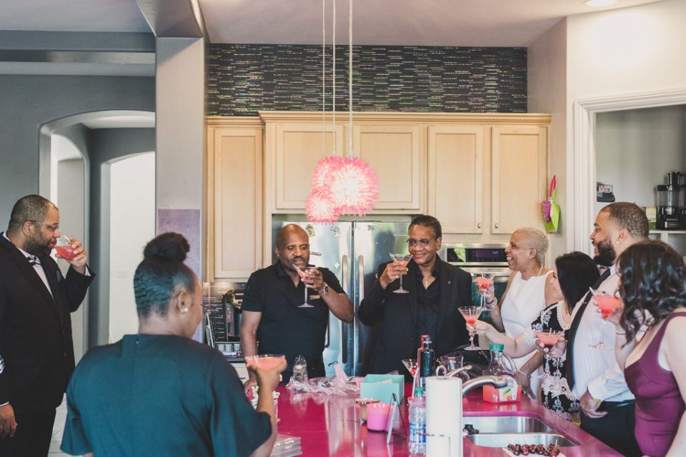 family enjoys martinis in Las Vegas home