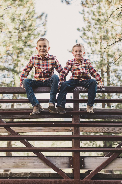 brothers sit on bridge in Las Vegas