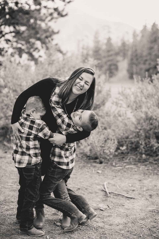 boys hug mom during Las Vegas family photos
