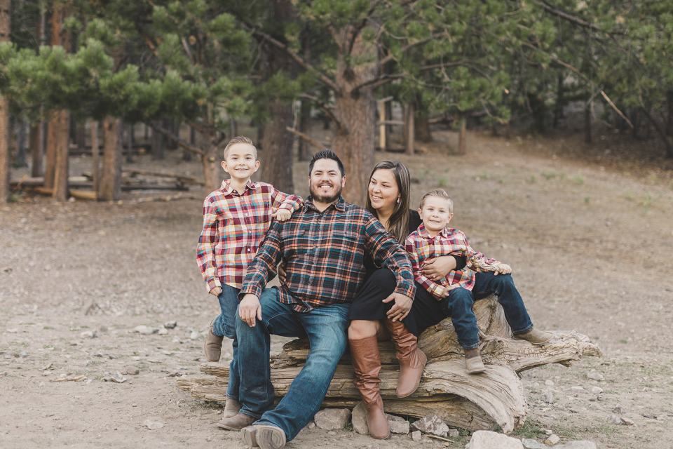 family sits on tree branch during Las Vegas Family Portraits