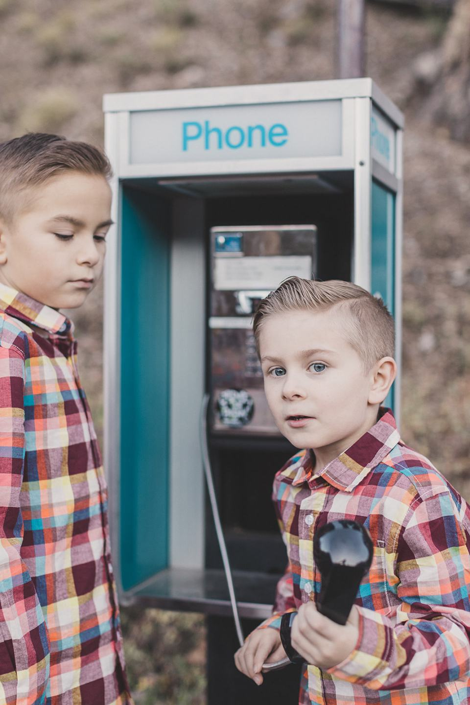 boys play with phone booth in Las Vegas