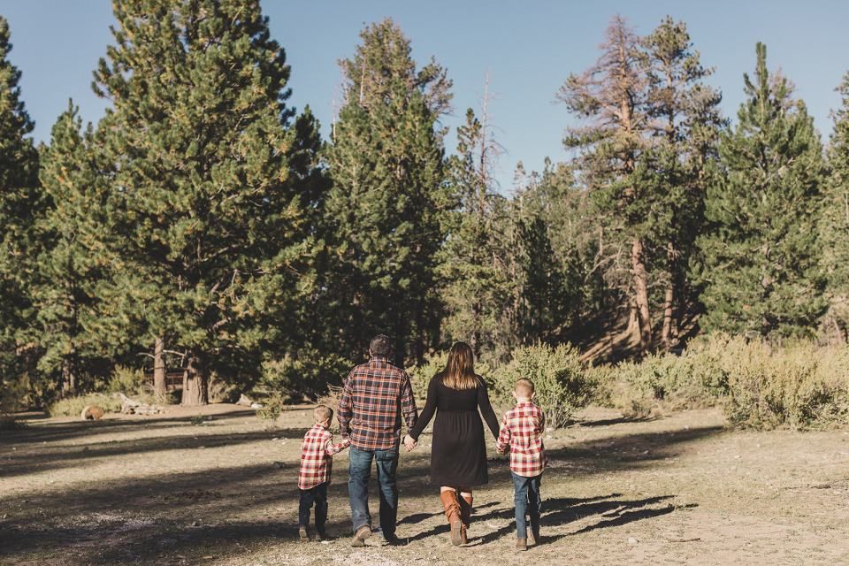 family walks into woods together during Las Vegas photos