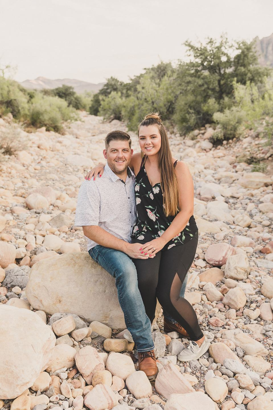 newly engaged couple poses on rocks in First Creek Canyon