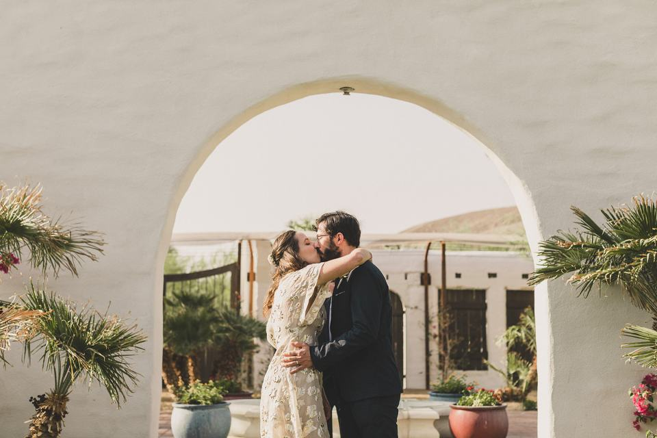 bride and groom kiss during Death Valley elopement ceremony