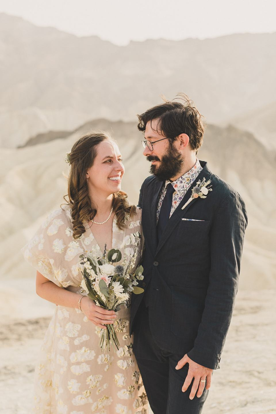 bride and groom laugh during portraits at Zabriskie Point