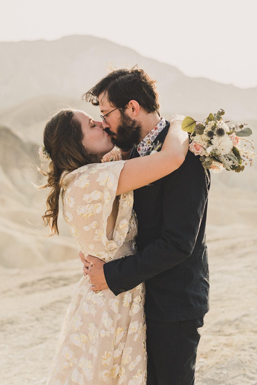bride and groom kiss at Zabriskie Point