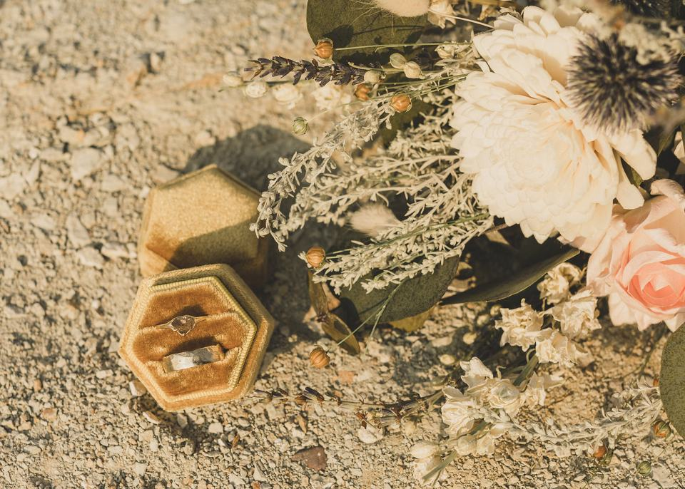 wedding rings on sand before Death Valley elopement