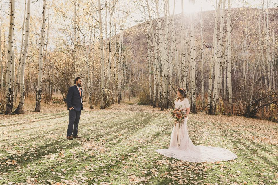 bride and groom pose on farm after Park City elopement