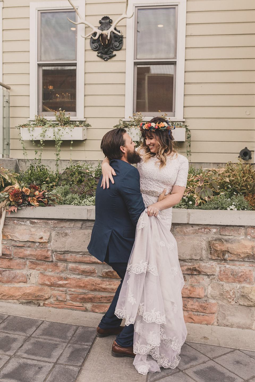 groom lifts bride wearing flower crown in Park City UT