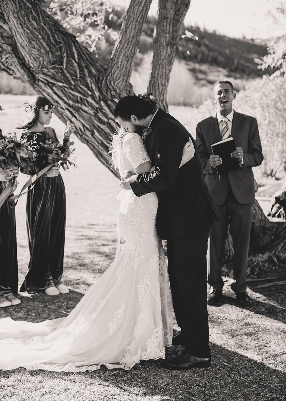 groom hugs bride after elopement ceremony