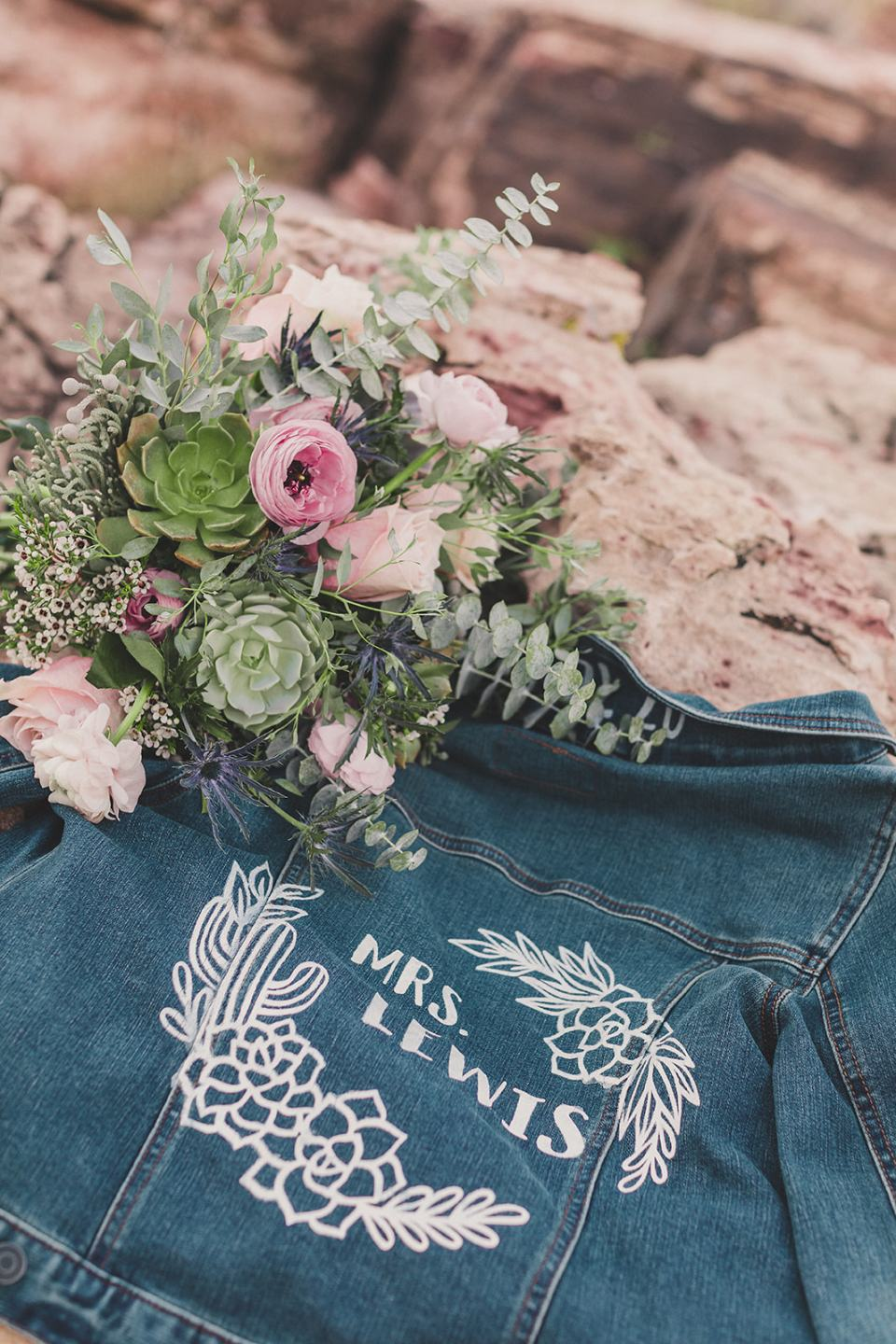 custom jean jacket and bride's bouquet for Red Spring Boardwalk elopement