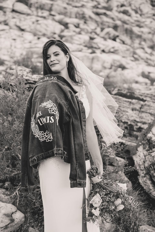 bride shows off custom jean jacket