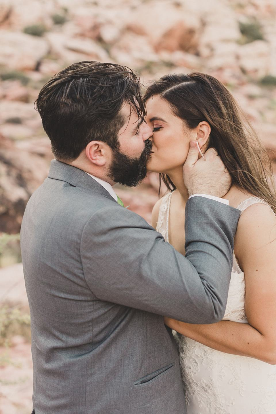 bride and groom kiss after Red Spring Boardwalk Elopement