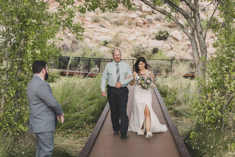 bride walks down aisle with dad at Red Spring Boardwalk