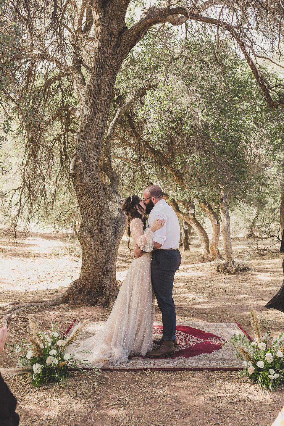 newlyweds kiss after Spring Mountain Ranch Elopement