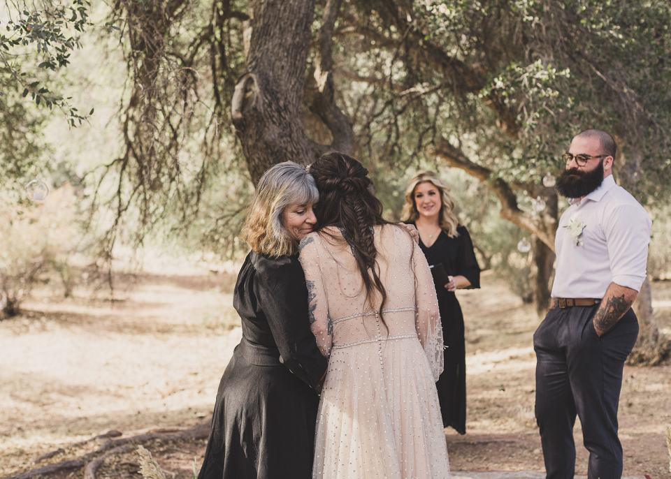 mom gives bride away during Spring Mountain Ranch Elopement