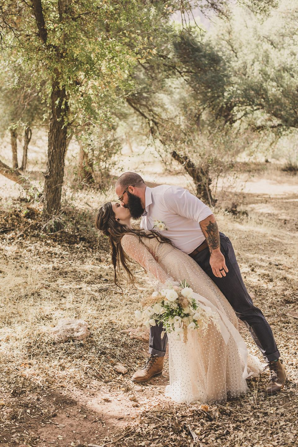 groom dips bride during portraits