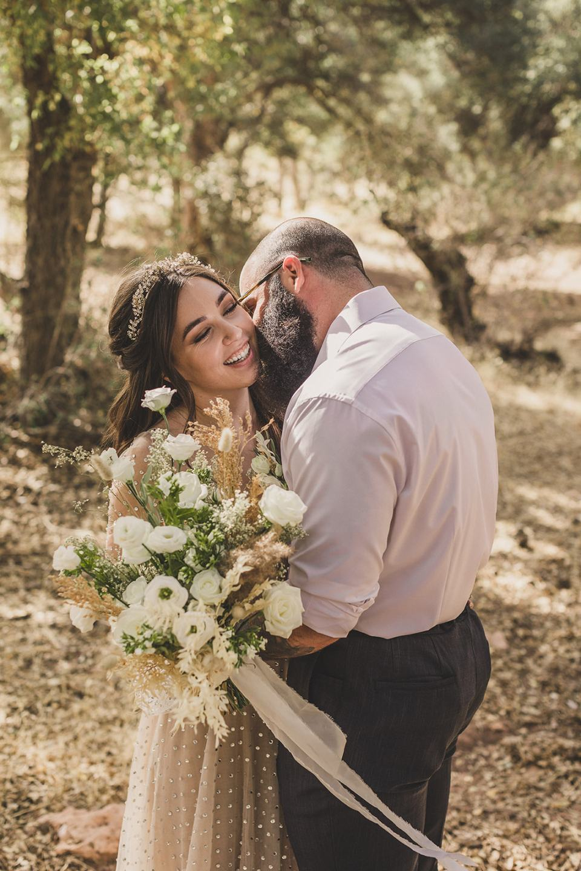 groom makes bride laugh during Spring Mountain Ranch Elopement photos