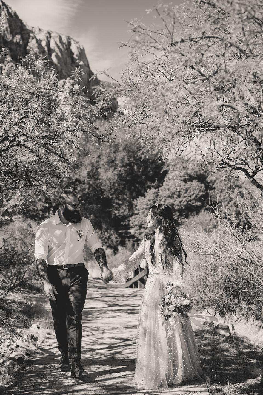 newlyweds walk through park after Spring Mountain Ranch Elopement