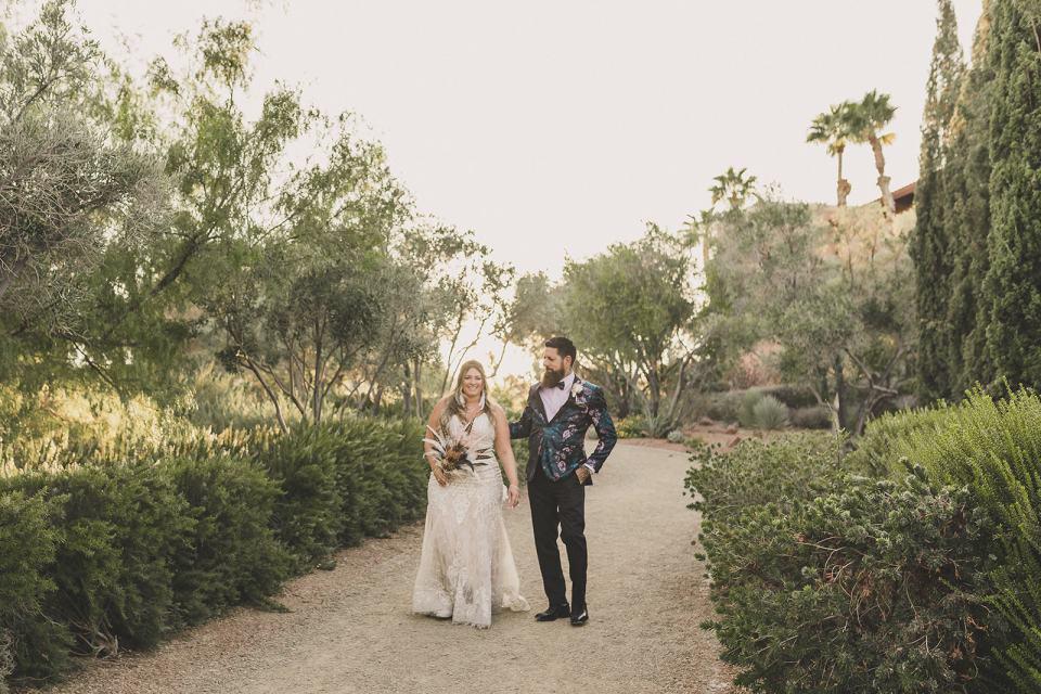 bride and groom walk on path at The Westin Lake Las Vegas