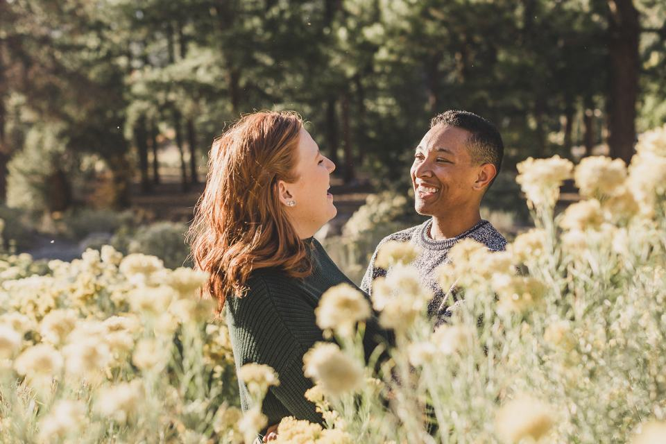 couple poses in fall flowers during Las Vegas family photos