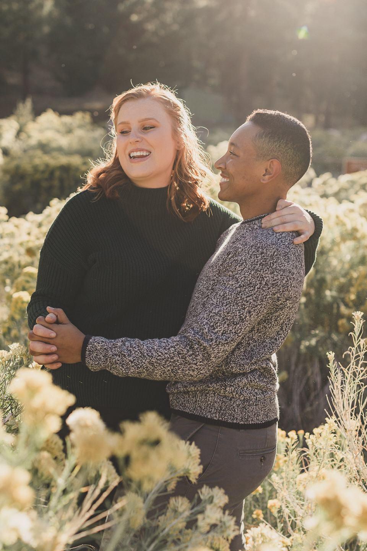 couple dances during fall portraits in Las Vegas