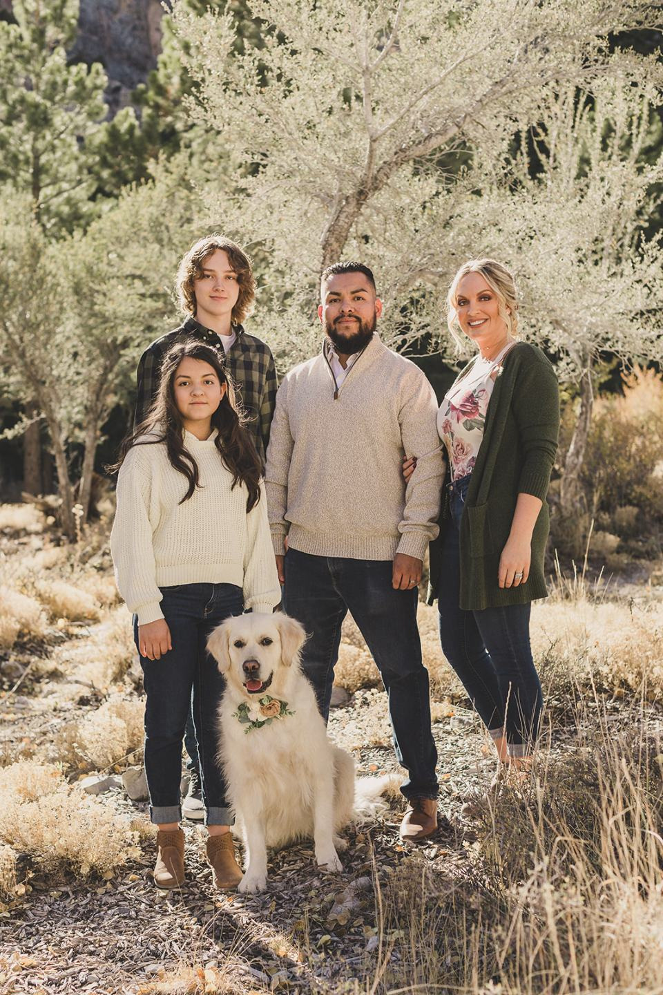 family of four poses with dog in Kyle Canyon
