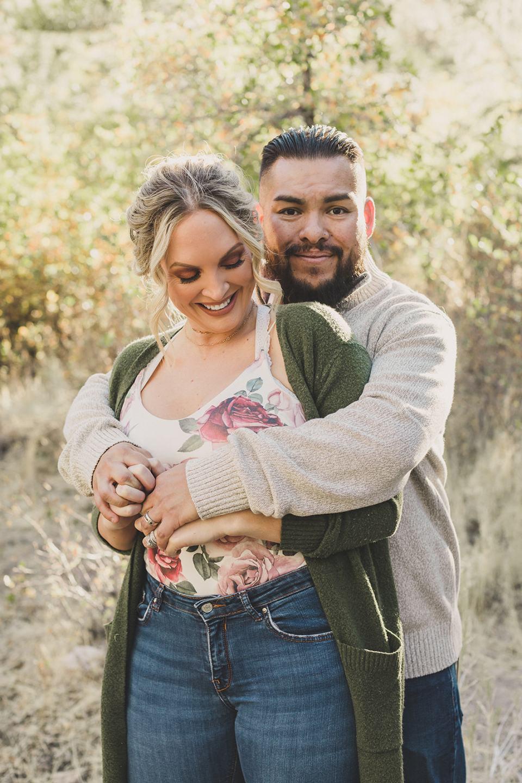 husband hugs wife during Las Vegas family photos