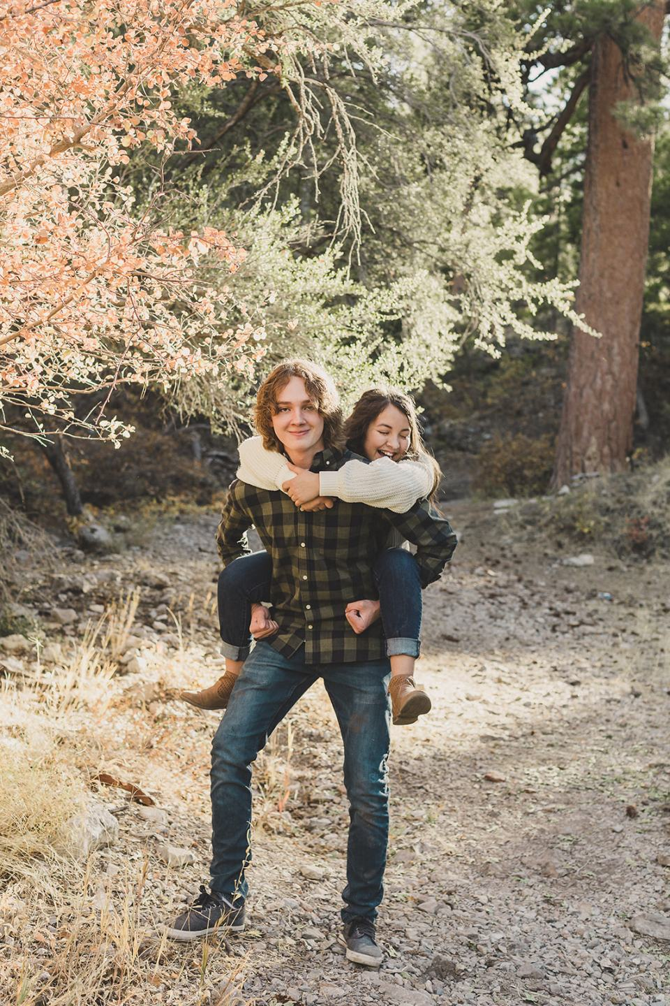 siblings do piggy back rides during Mt Charleston Family Portraits