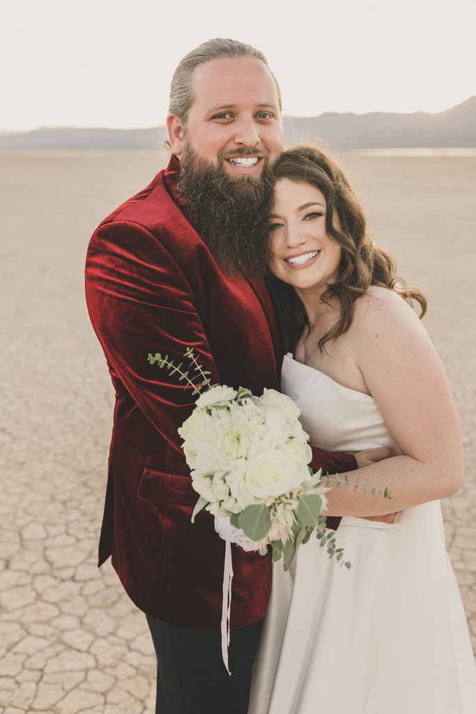 Las Vegas microwedding portraits of bride and groom with red velvet jacket
