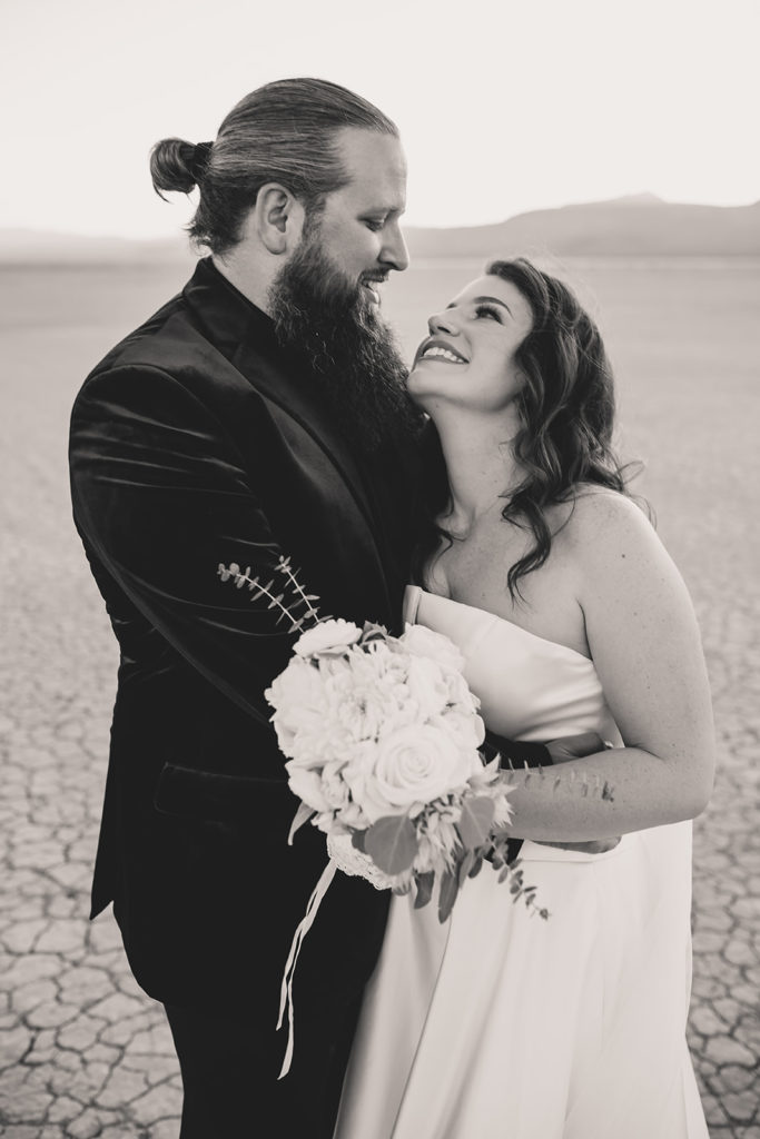 bride and groom pose together in desert