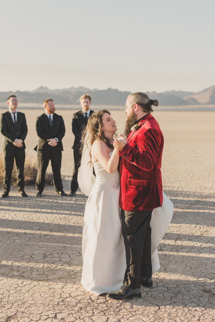 bride and groom have first dance in desert during Las Vegas microwedding