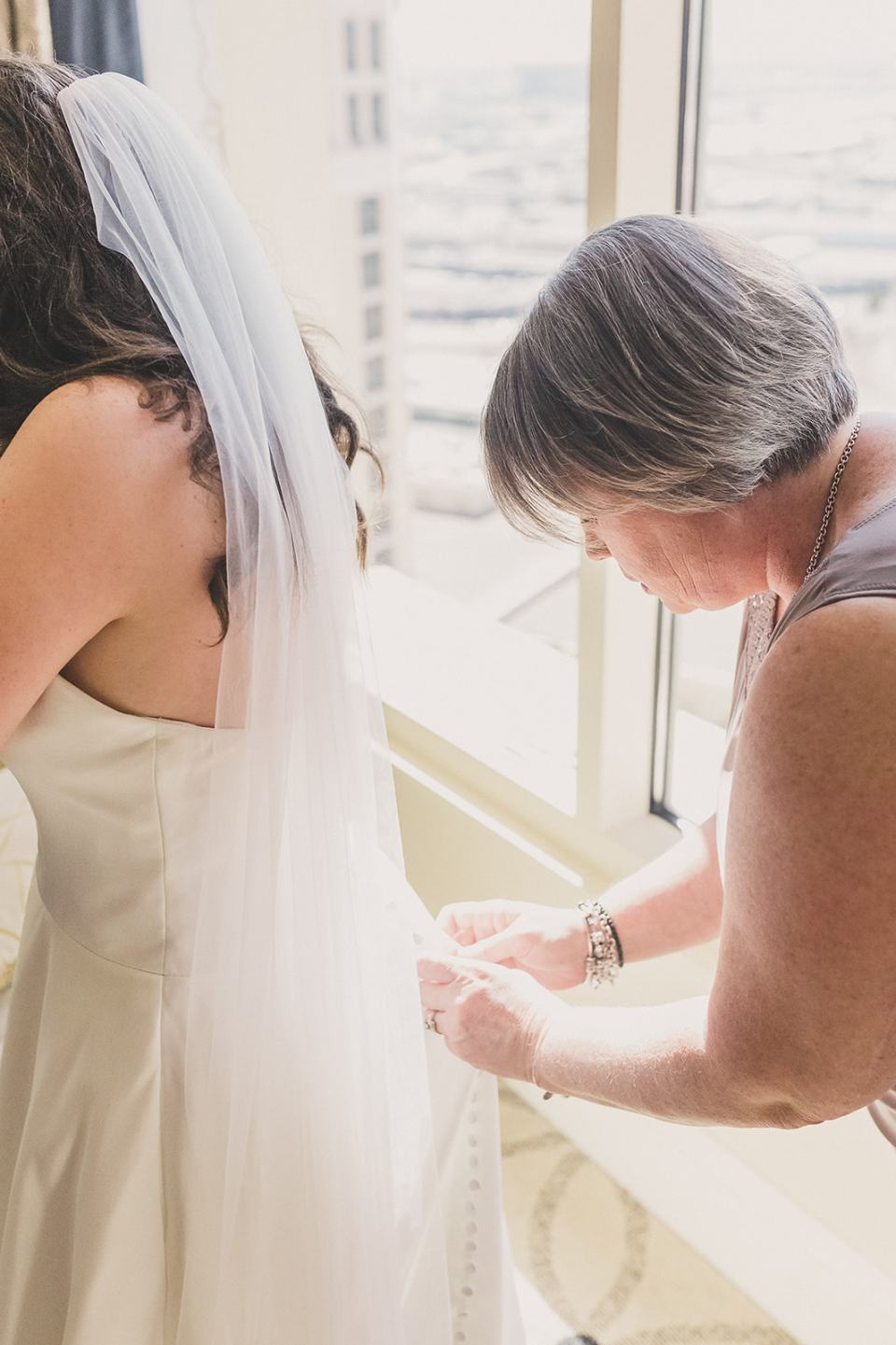 bride gets into wedding dress before NV wedding
