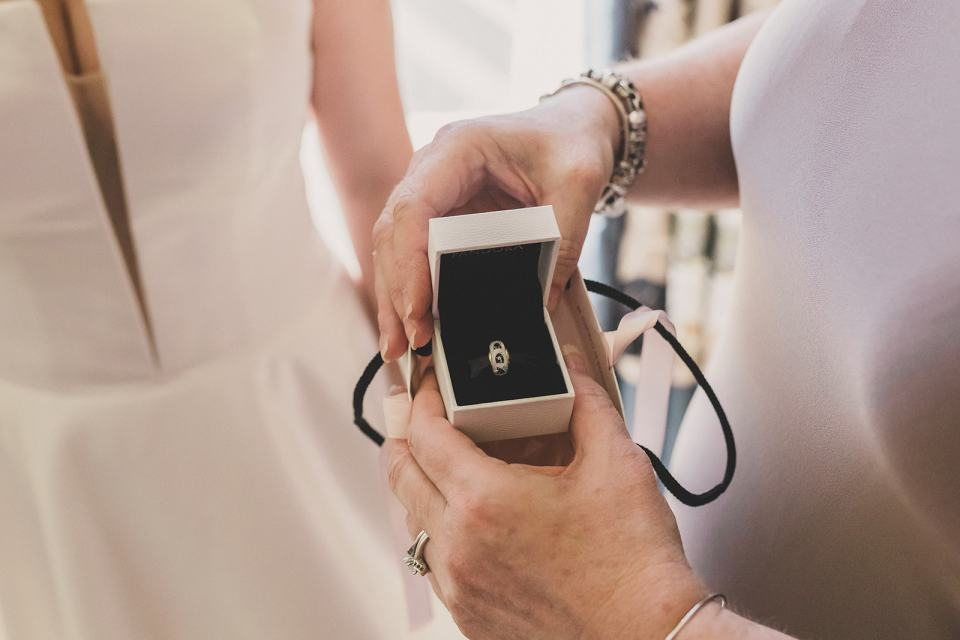 bride gives mother gift on wedding day
