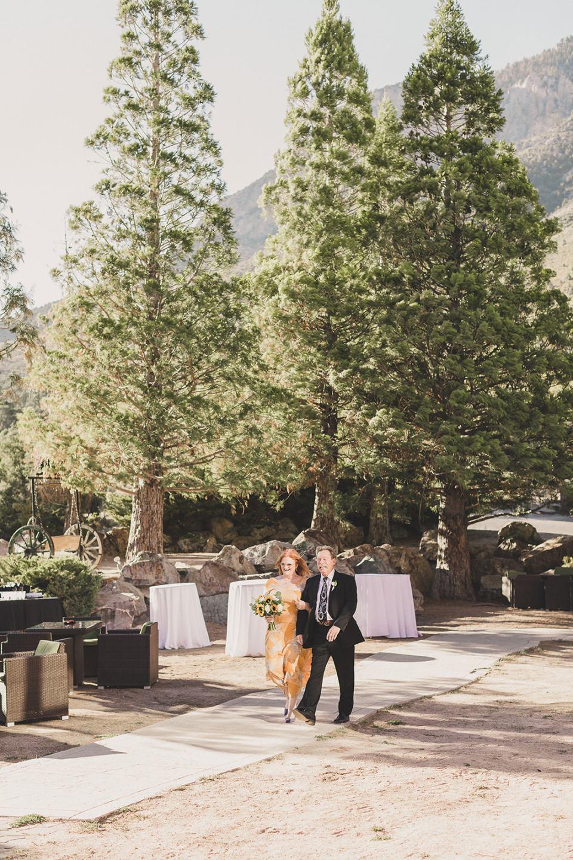 bride and groom walk to wedding ceremony at Mt Charleston Lodge Microwedding