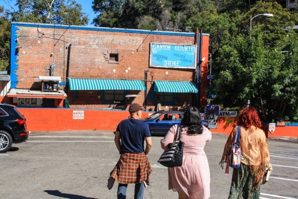 People on a tour of Laurel Canyon and Hollywood, near the Canyon Country Store
