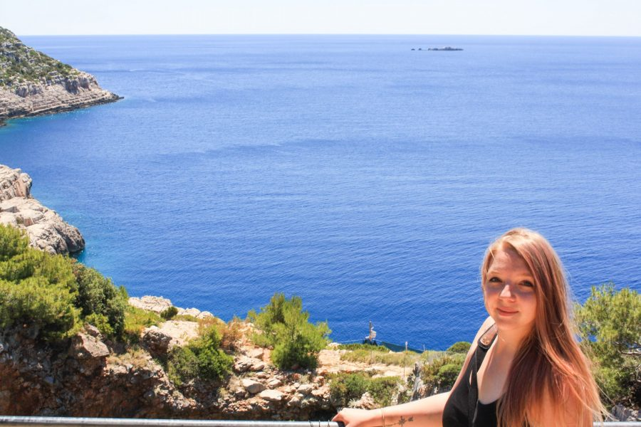 Taylor on a trip in the foreground with the Adriatic Sea and the coastline in the background