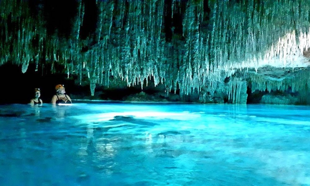 A photo of two girls caving with stalactites in Playa del Carmen, Quintana Roo Mexico