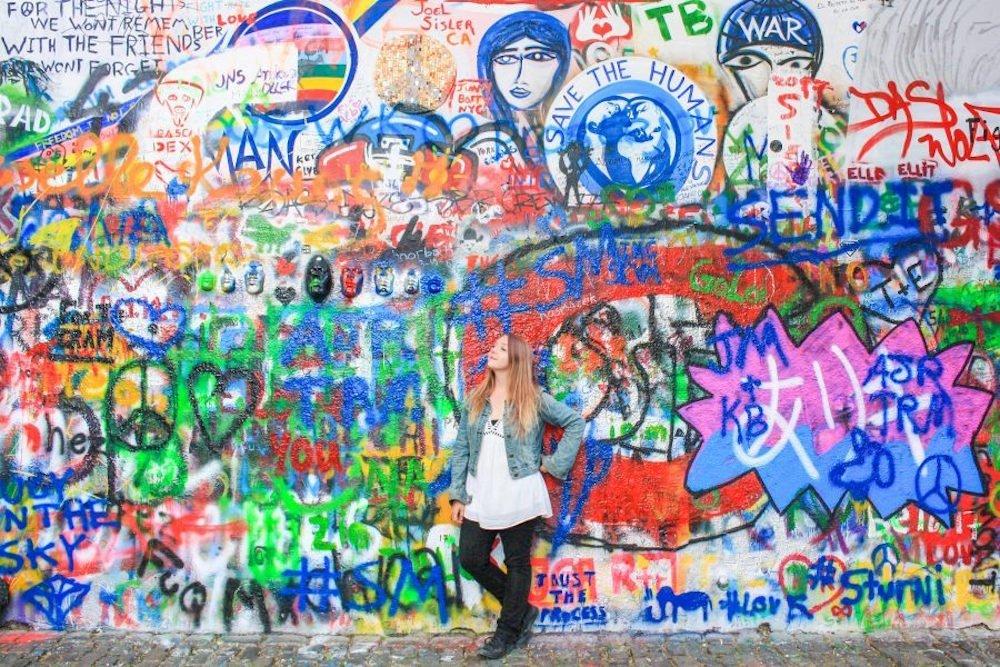 Standing in front of the John Lennon Wall in Prague, Czech Republic