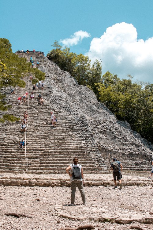 The main pyramid at the Coba Ruins, with people climbing on it