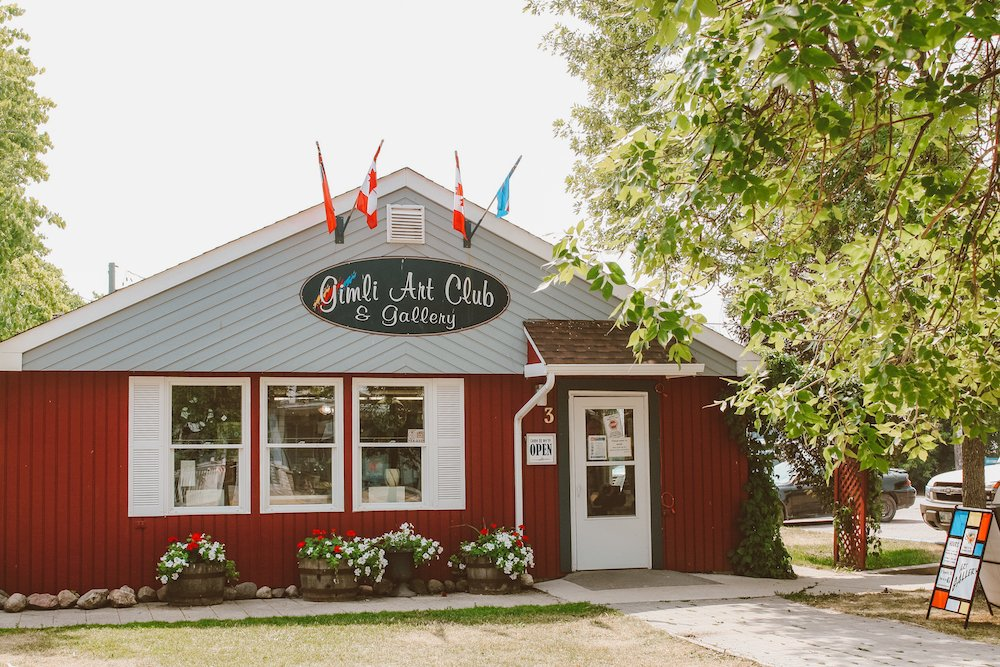 The outer red and grey facade of Gimli Art Club & Gallery in Gimli Manitoba