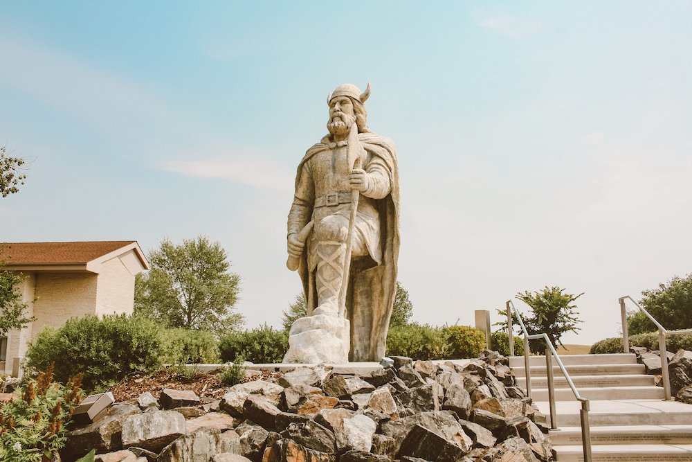 Viking statue in Gimli, Manitoba surrounded by walkways and gardens