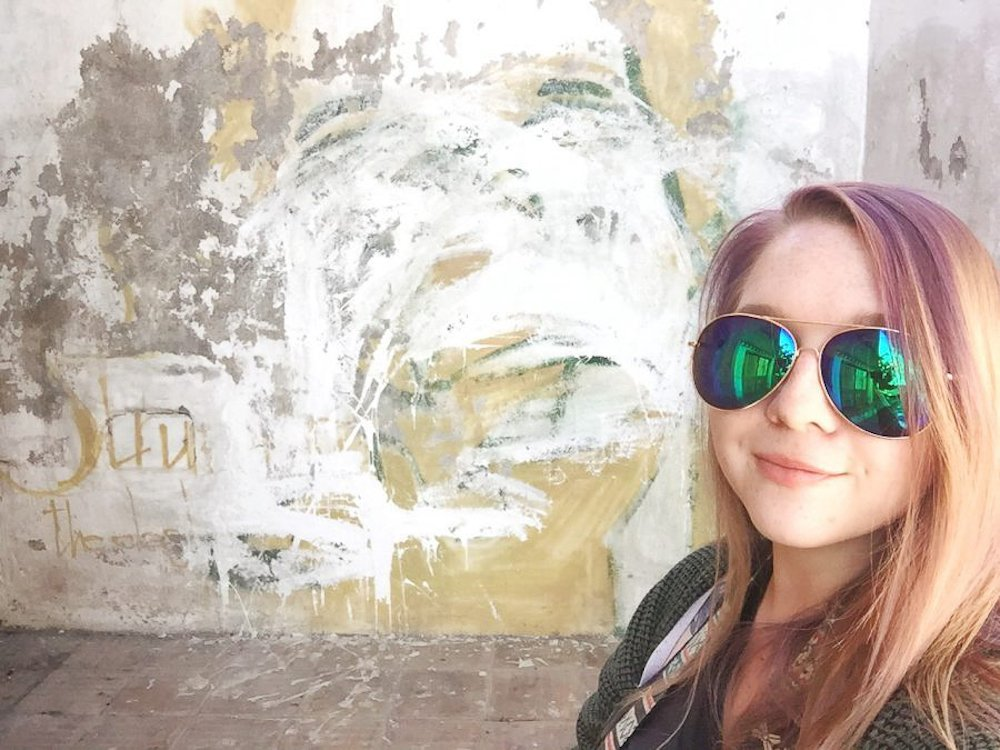 Taylor takes a selfie in front of Joe Strummer Plaza in Granada, Spain