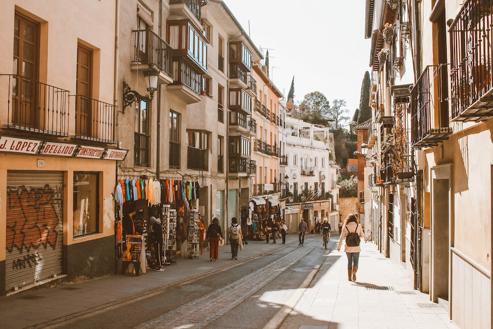 Downtown Granada Spain. A narrow street with shops and restaurants