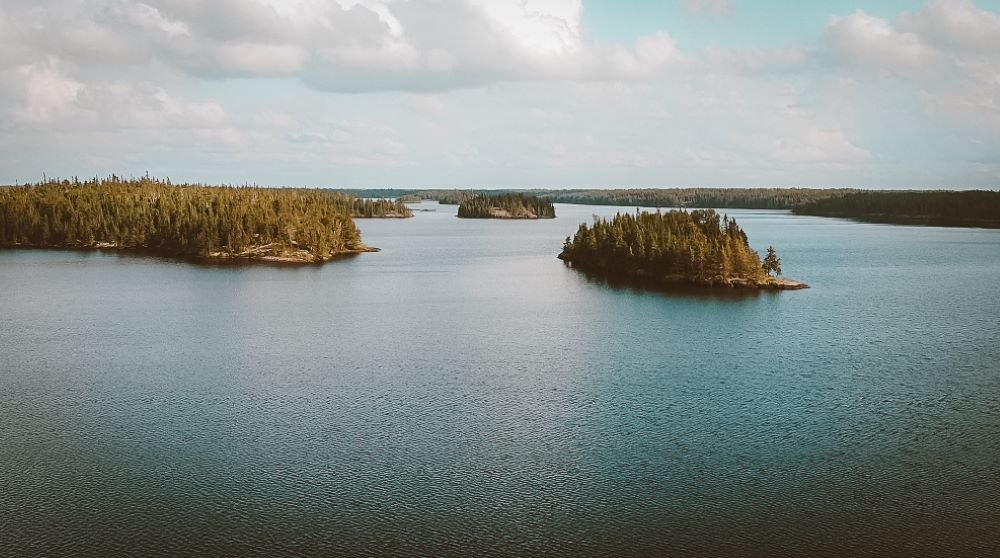 An aerial shot of Black Lake, Nopiming Provincial park. The scene depicts islands jutting out of the lake.