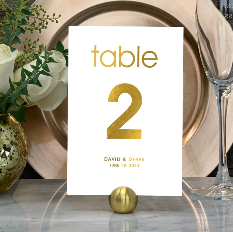 Our Modern Wedding Table Numbers are shown here in gold foil.