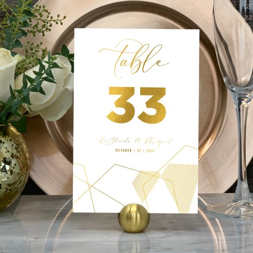 Our Geometric Wedding Table Numbers are shown here in gold foil.