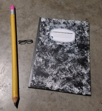 Image shows size of the oversized notebook and pencil next to my eye glasses.